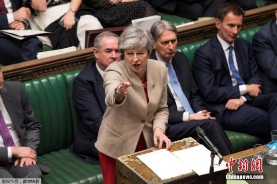 资料图:英国首相特蕾莎・梅。